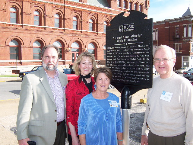 Former Iowa Music Educators Association President John Aboud,  (left), and former AssociationPresidents Lynn Brinckmeyer, Barbara Geer and David Circle helped dedicate the Centennial Plaque in Keouk in 2007.
