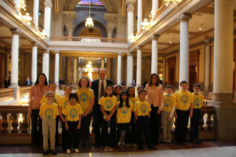 Students from East Washington Academy in the north atrium of the Indiana Statehouse, along with Pete Weldy (center) Special Assistant to the Democratic Leader Indiana House Democratic Caucus, Jeff Hartsough, Executive Director, PAS, Michelle Bade East Washington Academy, Tonya Angle, IMEA President (far right)