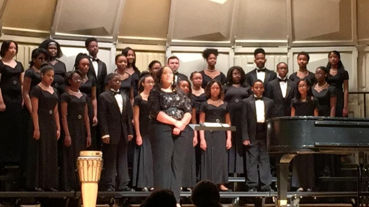 Angelica Brooks (front row center) with one of her choral groups.