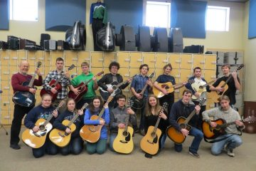 guitar students group photo in classroom