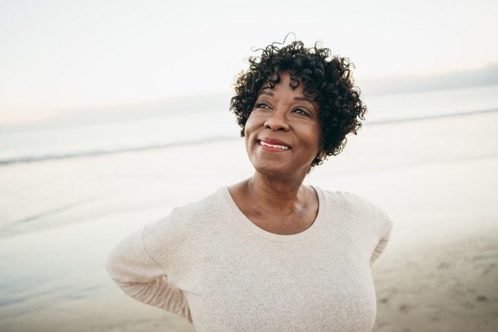 senior citizen smiling on beach