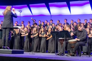 2018 All-National Honor Ensembles mixed choir performing on stage under the direction of Dr. Amanda Quist