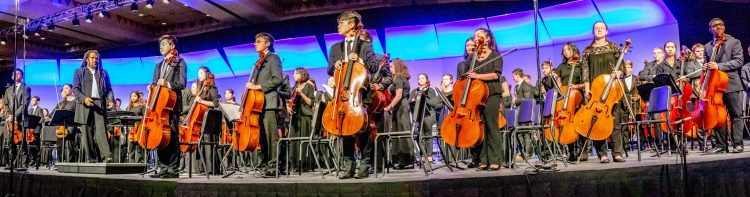 2018 All-National Honor Ensembles symphony orchestra showcase talents on stage with Dr. Jean Montès