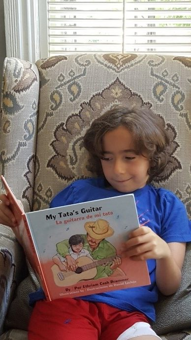 boy reading My Tatas Guitar