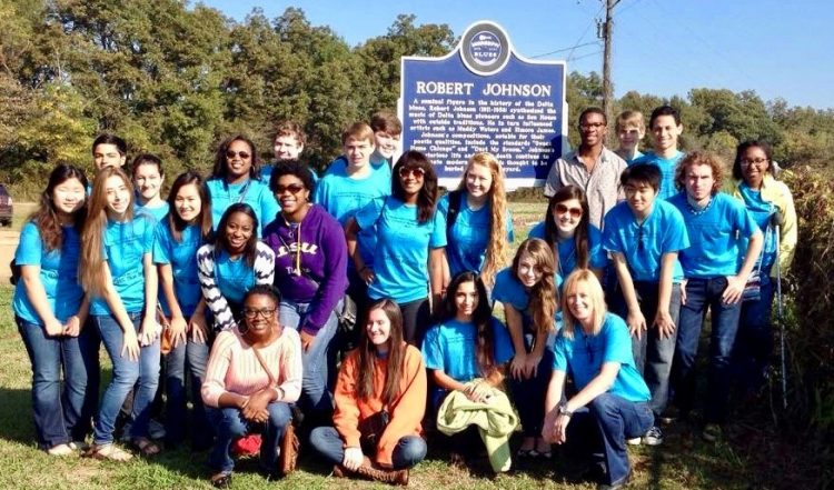 class picture in front of Robert Johnson historical marker