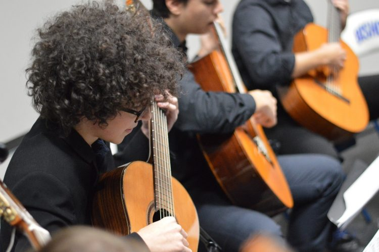 guitar students in class wearing black