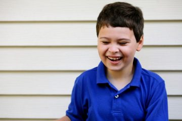 Portrait of laughing boy with autism