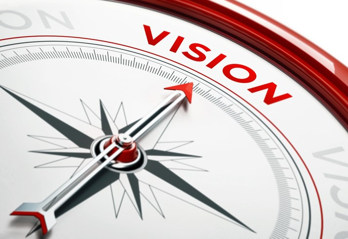 compass with arrow pointed to the word vision