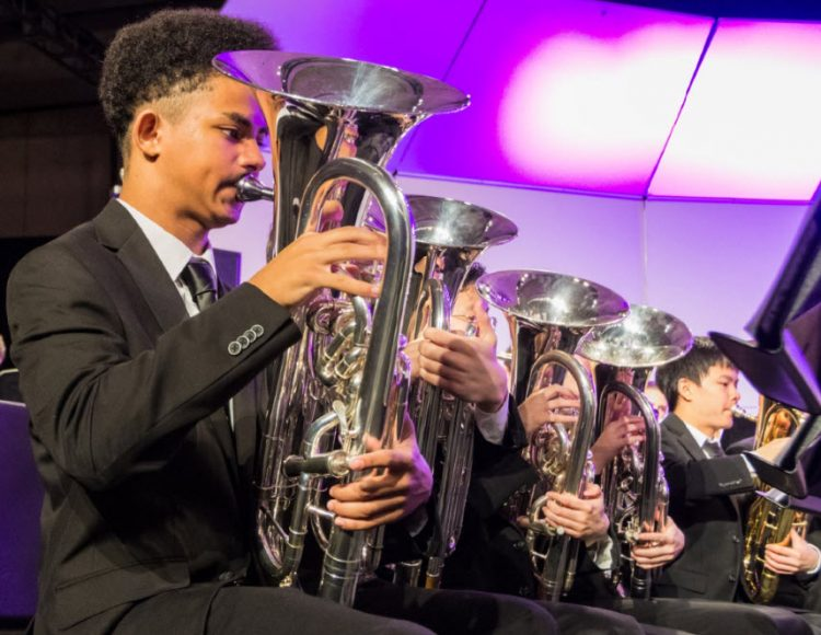 All-National Honor Ensembles Concert Band brass performers on stage