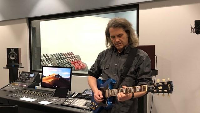 Guitar teacher David Singleton playing guitar