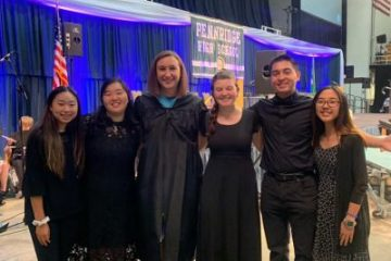 Marissa Guarriello and some of her music students in black concert attire