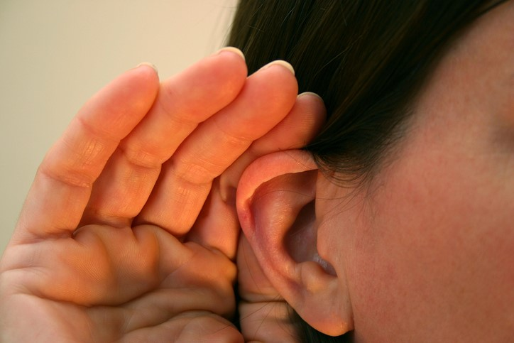 image of woman's ear cupped to hear more closely