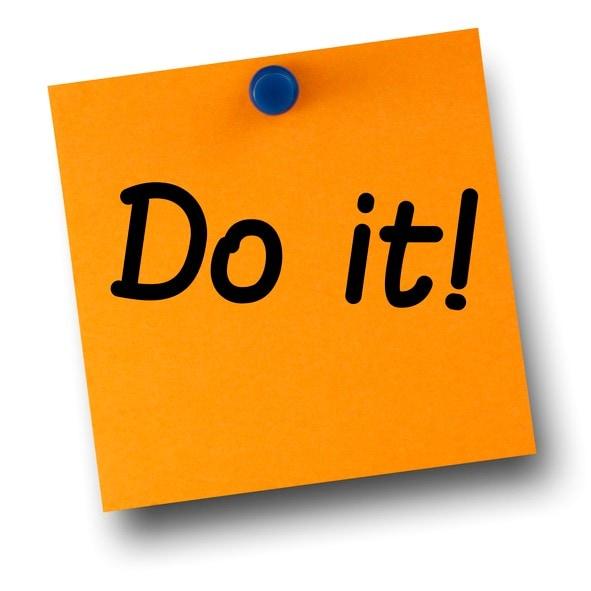 Do it orange postit affixed with blue small thumb tack on white