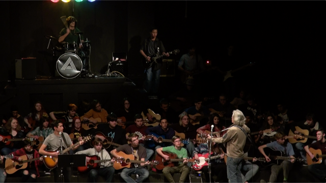 large guitar ensemble performing