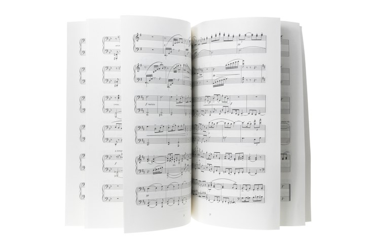 Pages of a musical score displayed artistically