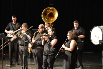 Band students on stage wearing black