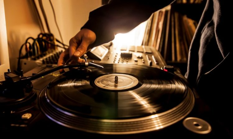 Dj in studio with turntable