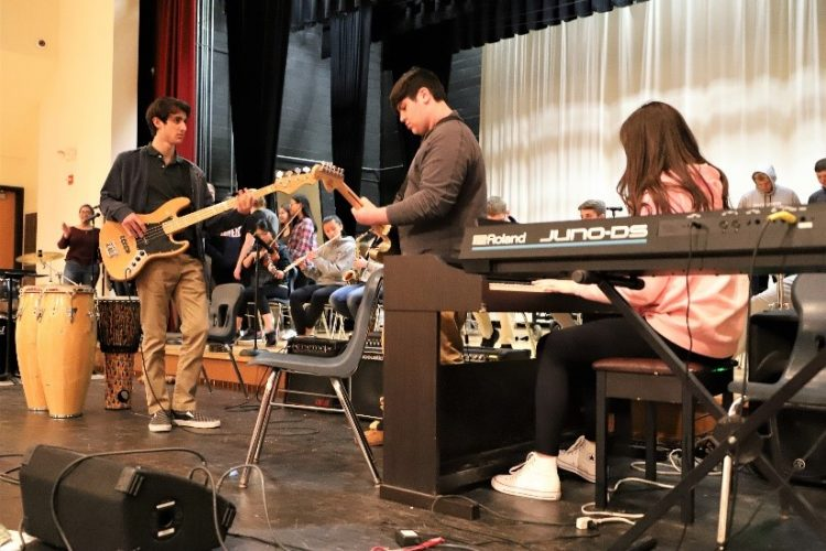guitar students on stage