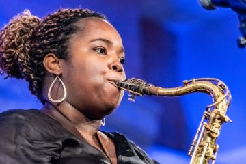 high school female student playing saxophone
