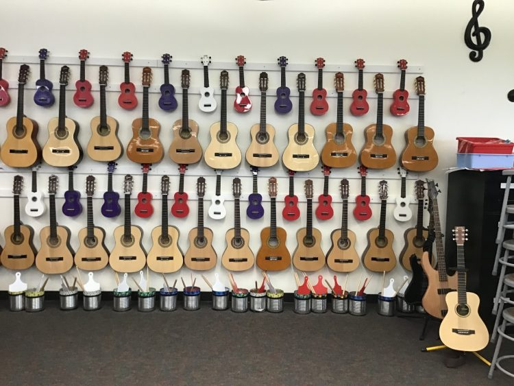 guitars and ukuleles stored hanging on classroom wall in the Centennial state of Colorado