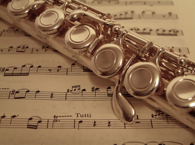 Macro of flute detail on sheet music with tutti written