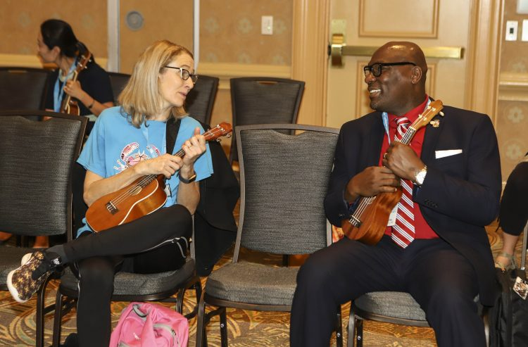 two music educators with ukuleles at 2019 NAfME conference