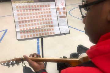 guitar student with music stand