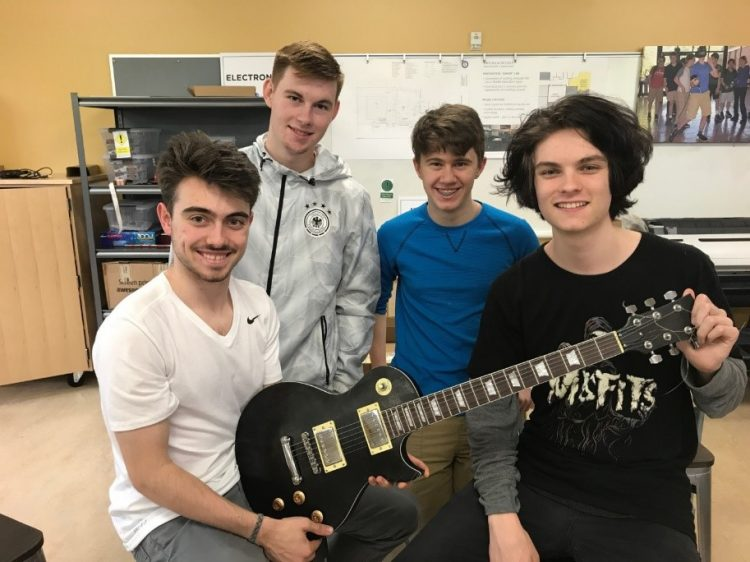 students with completed guitar image 10