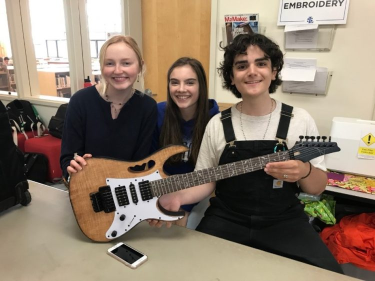 students with completed guitar image 11