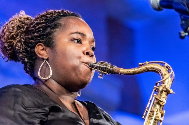 young woman playing saxophone