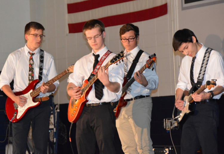 four male guitar students in the Constitution state of Connecticut