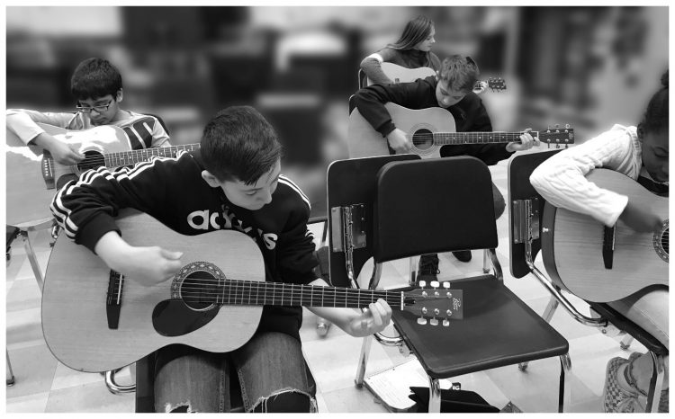 students with guitars