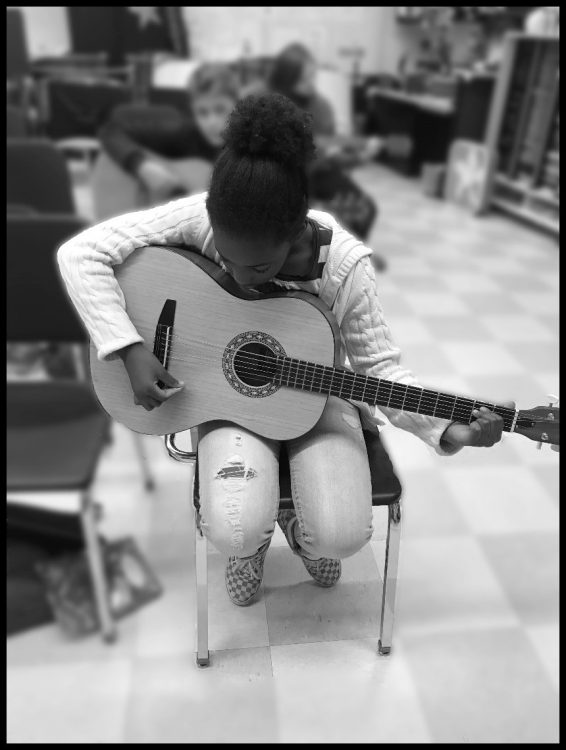 young female student with guitar