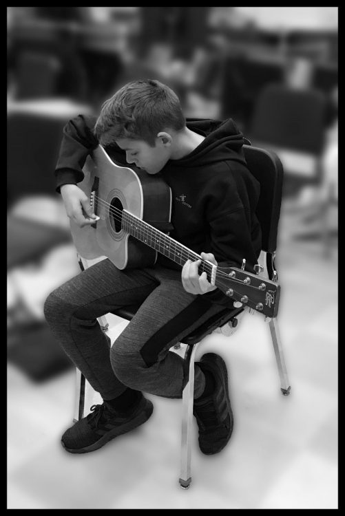 young male student with guitar