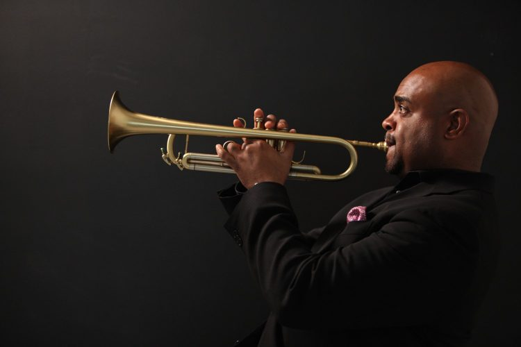 Terell Stafford profile photo playing trumpet