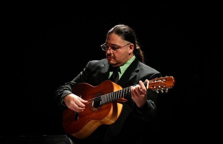 Eduardo Trujillo playing guitar