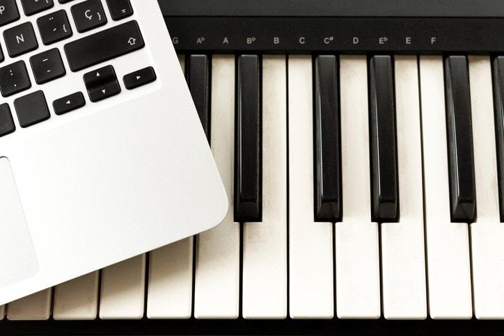 piano keyboard and computer