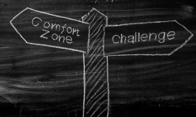 Comfort Zone - Challenge signpost drawn on a blackboard