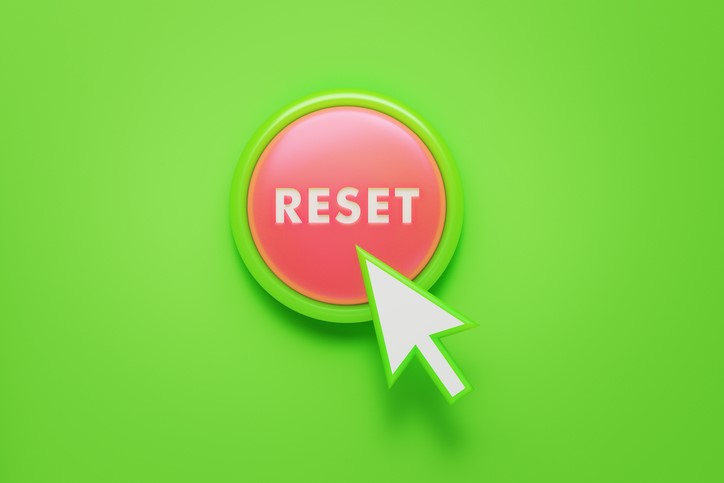 reset button with computer cursor arrow over button green background