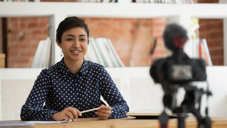 South Asian woman recording self-introduction or educational video