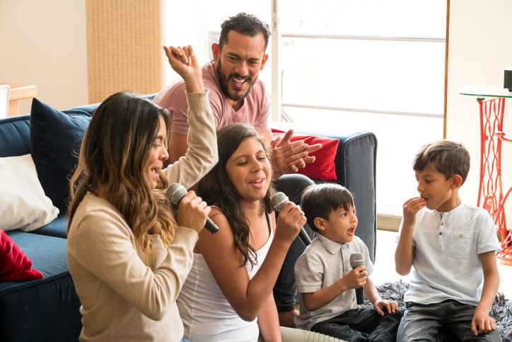 Latin family singing laughing in the living room