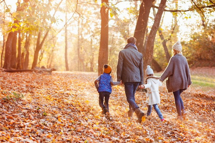 Family enjoying beautiful fall day in the park