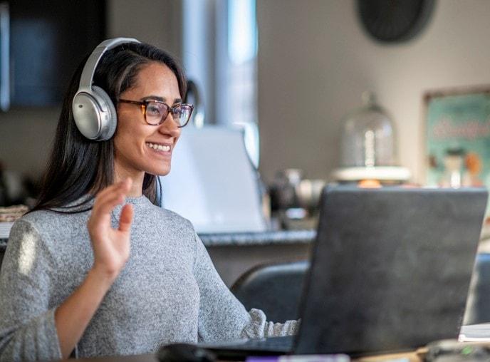 teacher on laptop with headphones
