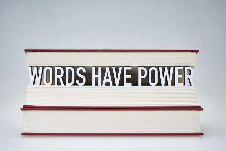 WORDS HAVE POWER text in midst book pages