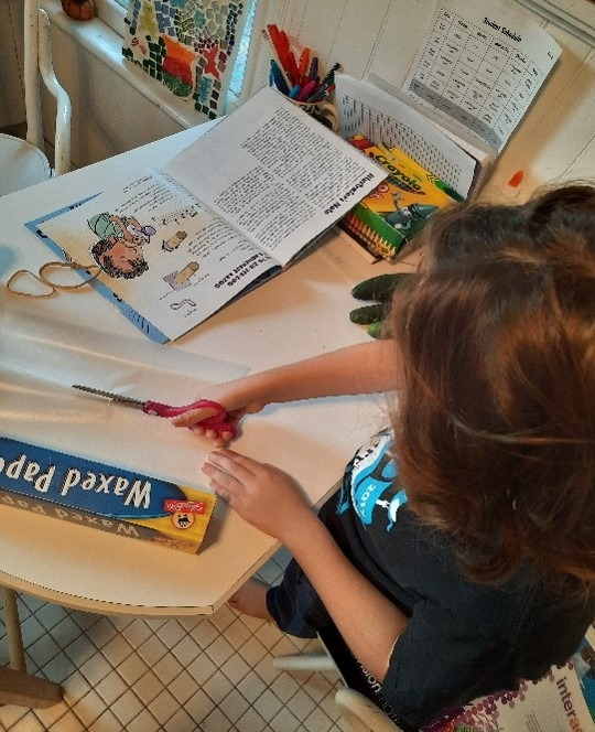 child with storytime book making a kazoo