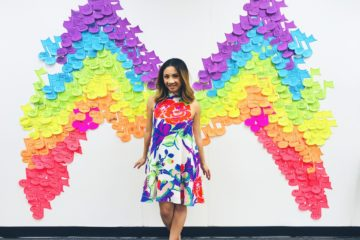 music teacher with music note rainbow wings