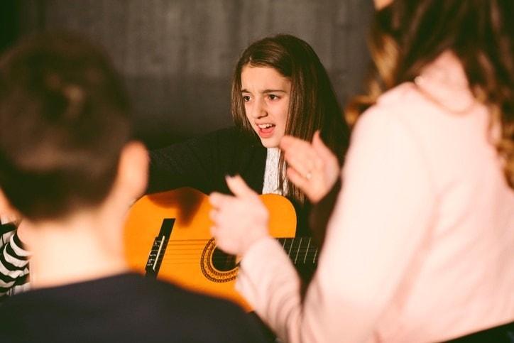 School Play Rehearsal girl with guitar