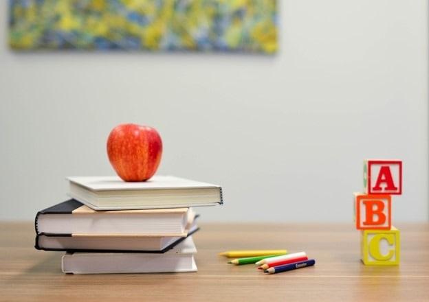 books apple pencil alphabet blocks on desk core curricula