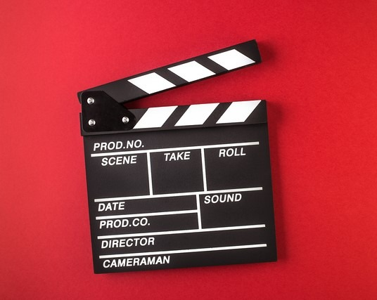 Clapperboard on red background