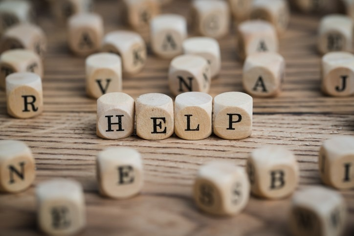 wooden dice forming the word HELP